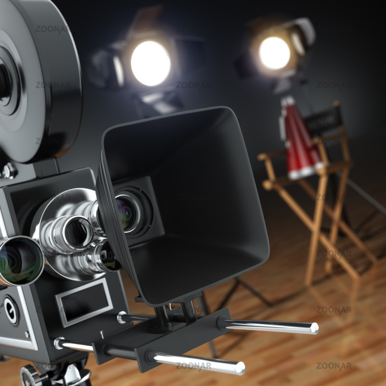 Video, movie, cinema concept. Retro camera, flash and director's chair in dark studio with dof effect.