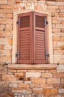 Old dilapidated weathered brown wooden shutters