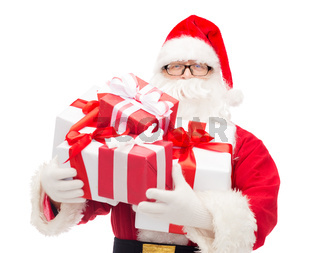 man in costume of santa claus with gift boxes