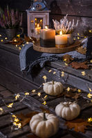 Autumn terrace or patio in night with pumpkins