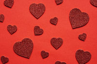 love themed red background with various glitter hearts