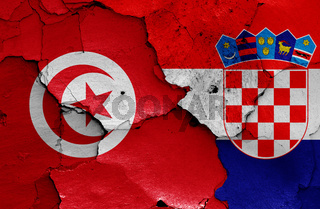 flags of Tunisia and Croatia painted on cracked wall