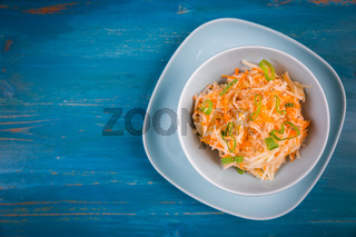 Healthy food - Dietary carrot and kohlrabi salad with shallots and sesame seeds