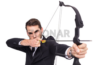 Smart businessman practicing archery looking at camera