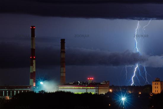 lightning at night near the factory