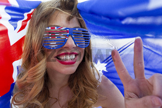 Patriotic woman showing peace sign