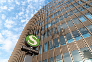 Low angle view of Friedrichstrasse railway station sign against modern office building