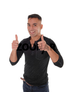 Young handsome man signs both thumb up