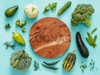 Green vegetables on green background, copy space