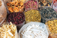 Heaps of tea, dried herbs and grocery at asian street market