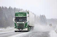 Semi Trailer Trucks on Highway in Snowfall