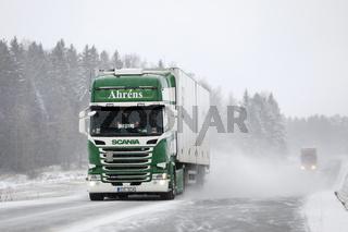 Semi Trailer Trucks on Highway in Snowfall