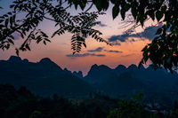 Xianggong Hill viewpoint view of Yangshuo region karst landscape at dusk