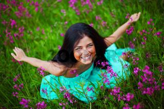 Woman on summer flower field