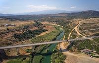 Aerial view on road bridge over river near Geropotamos beach on Crete, Greece.