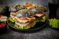 Delicious black hamburger with patties and cheese