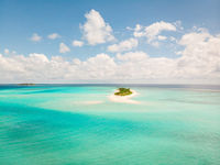 Picture perfect beach and turquoise lagoon on small tropical island on Maldives
