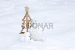 Simple Christmas tree, baubles and decoration in fresh snow