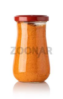 red basil pesto sauce in glass jar