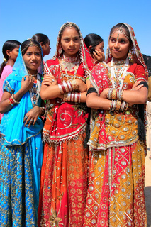 Young women in traditional dress taking part in Desert Festival, Jaisalmer, India