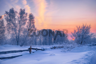 Siberian rural winter landscape. Dawn in the countryside.