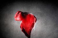 Bursted dreams - heart shaped ballon shot by a bullet