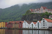 Old hansaetic wooden houses built in row at wharf of Bergen fjord are UNESCO World Heritage site and very popular for turists