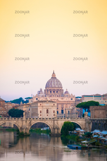 Sunset on Tiber river bridge with Vatican City - Rome, Italy