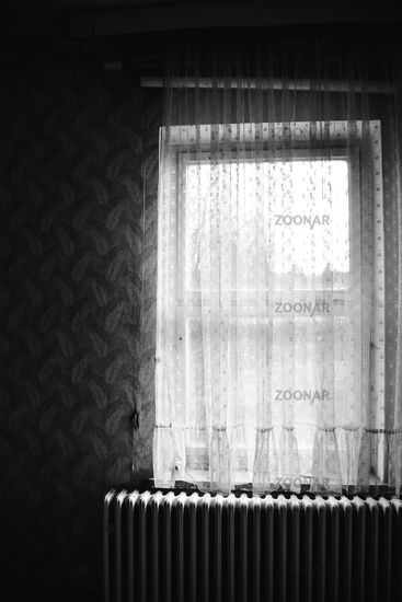 old window with curtain in black and white