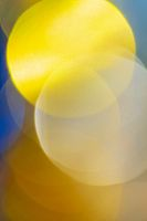 Beautiful defocused abstract blurry bokeh background yellow color. Festive Christmas lens flare photo effect