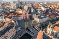 Aerial drone view of Preseren Squere and Triple Bridge over Ljubljanica river,Tromostovje, Ljubljana, Slovenia. Empty streets during corona virus pandemic social distancing measures