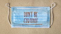 do not be covidiot - text on a face mask