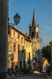 Alley and village church in Villars
