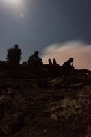 Silhouettes of people at Erta Ale volcano, Ethiopia