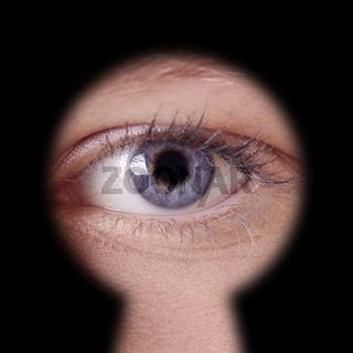 eye looking through keyhole