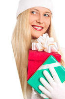 Young blonde girl with gift boxes in Christmas, woman and presents in winter season for shopping sale and holiday brand