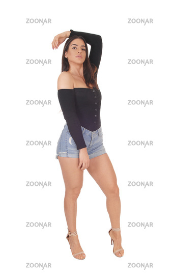 Beautiful happy young woman standing in shorts