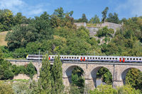 Luxembourg city with historic bridge near Kirchberg and passing train
