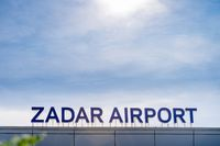 Sign Zadar Airport on the roof of the international airport