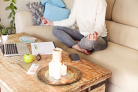 Relaxed woman meditating at home