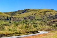 Desert road between the hills