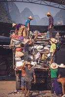 Chinese people working on metal recycling yard