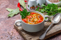 Thick vegetable soup with lentils and peas.