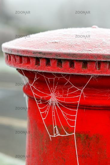 EAST GRINSTEAD, WEST SUSSEX, UK - JANUARY 10 : Hoar frost on a red pillar box in East Grinstead, West Sussex on January 10, 2021