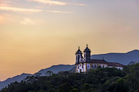 Ancient and historic church on top of the hill during sunset at Ouro Preto city
