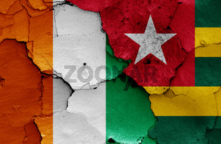 flags of Ivory Coast and Togo painted on cracked wall