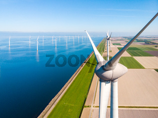 Wind turbine from aerial view, Drone view at windpark westermeerdijk a windmill farm in the lake IJsselmeer the biggest in the Netherlands,Sustainable development, renewable energy