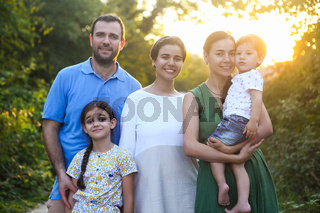 Portrait of the big happy family. Parents with children in countryside