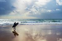Surfer  surfboard beach Portugal Algarve
