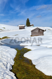 river, hit and snow hills in Alps
